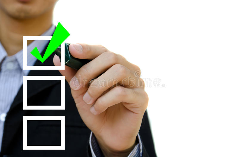 Young business hand with pen mark the check boxes. stock photos