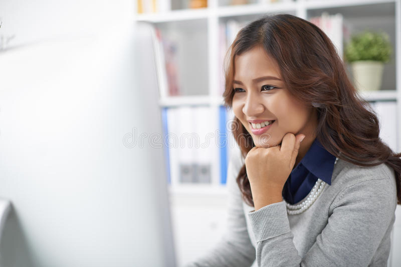 Young business lady. Beautiful young business lady working on computer stock photos