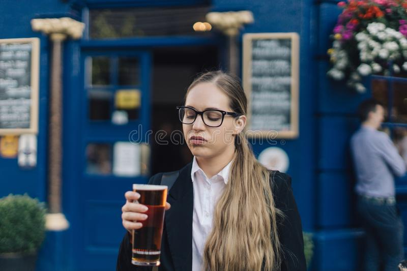 Young business lady with beer. royalty free stock image