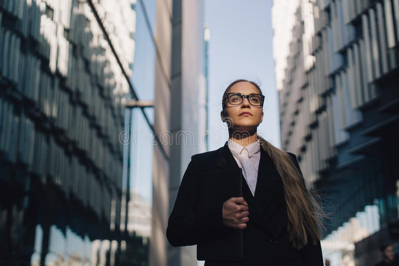 Young business lady between two buildings. royalty free stock photo