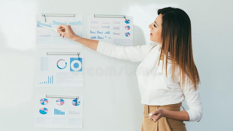 Business lady presentation analysis infographics royalty free stock photography