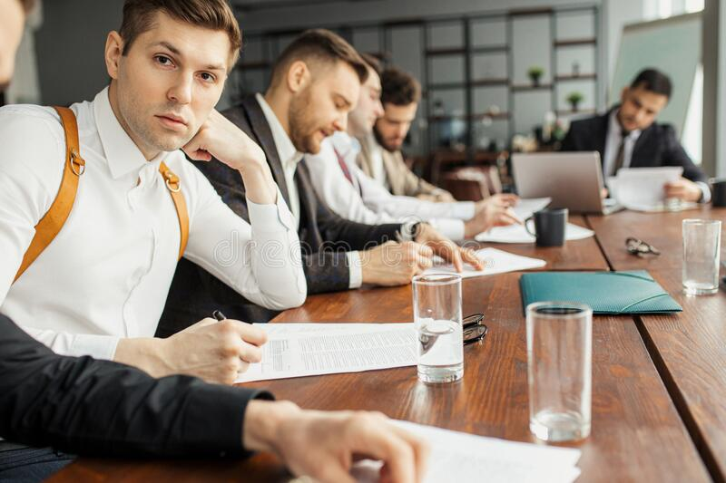 Young business males in boardroom stock photo