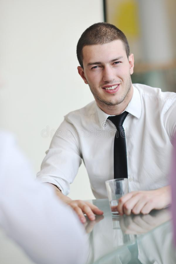 Download Young Business Man Alone In Conference Room Stock Photo - Image of fashion, laptop: 18727118