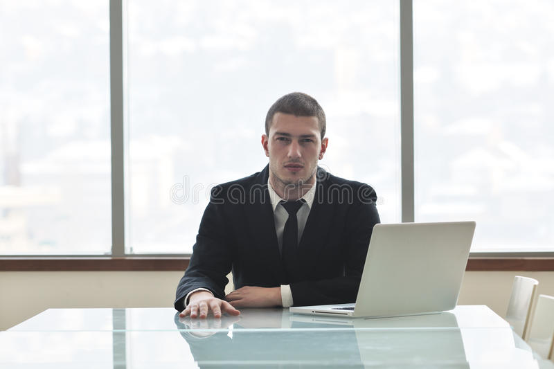 Download Young Business Man Alone In Conference Room Stock Photo - Image: 18730222