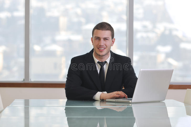 Download Young Business Man Alone In Conference Room Stock Photos - Image: 18730263