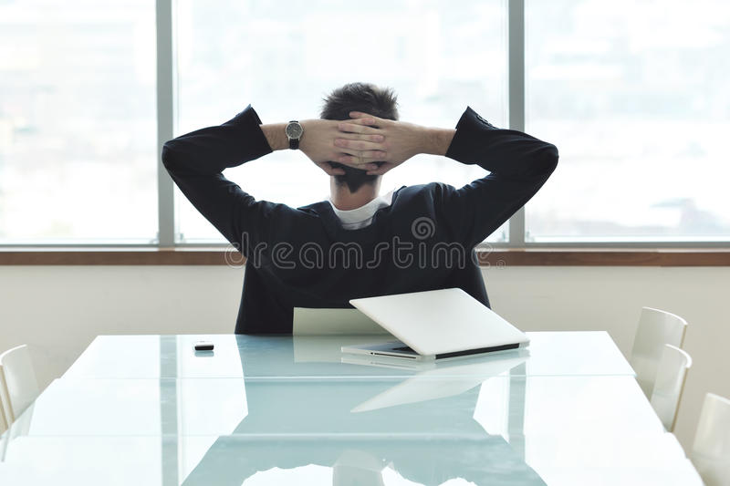 Young business man alone in conference room stock photo