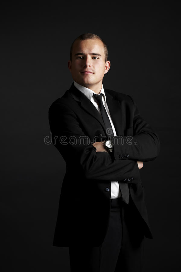 Young business man on black royalty free stock photo