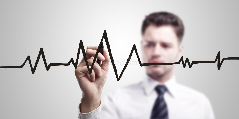 Young business man drawing chart heartbeat stock photo