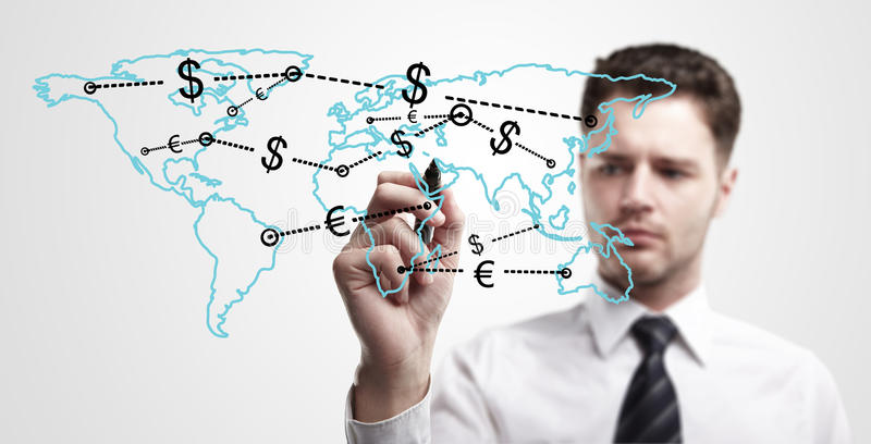 Young business man drawing a global network. With Dollar Signs on world map. The metaphor of international communication around the world. On a gray background