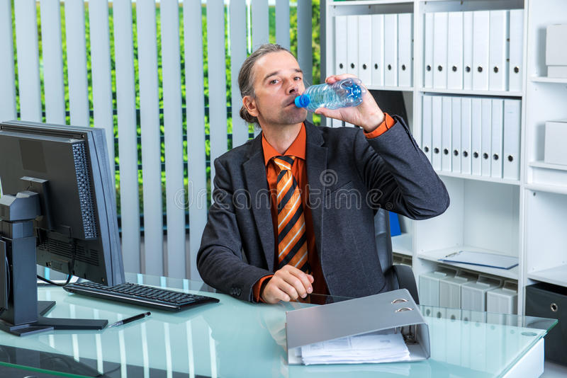 Young business man drinking water stock photo