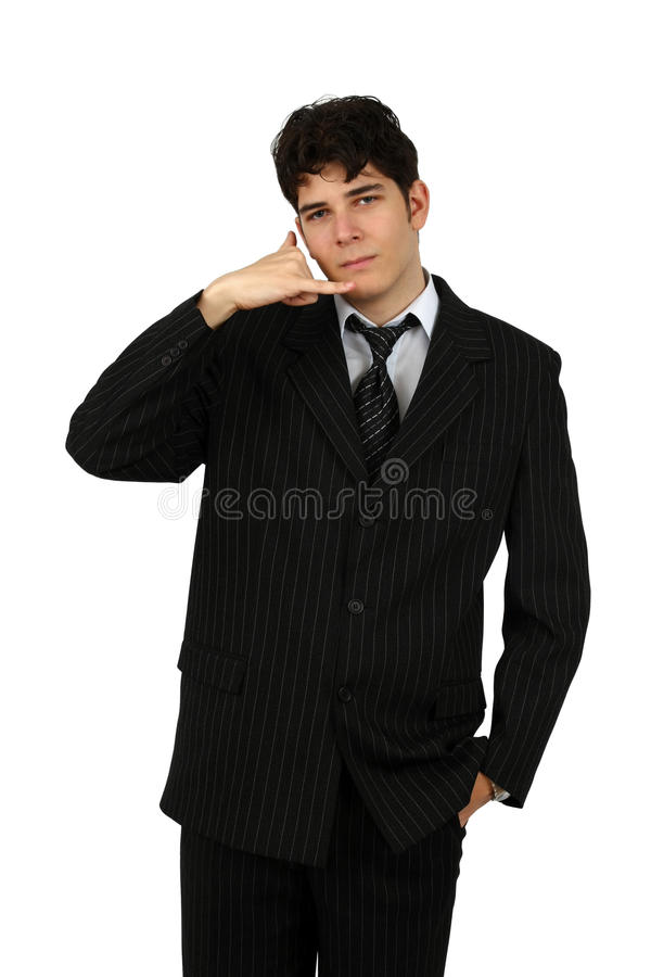 Young business man gesturing a call isolated