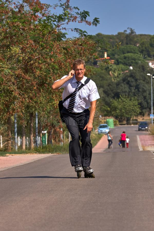 Young business man going to work with inline skate, alternative transport.  stock image