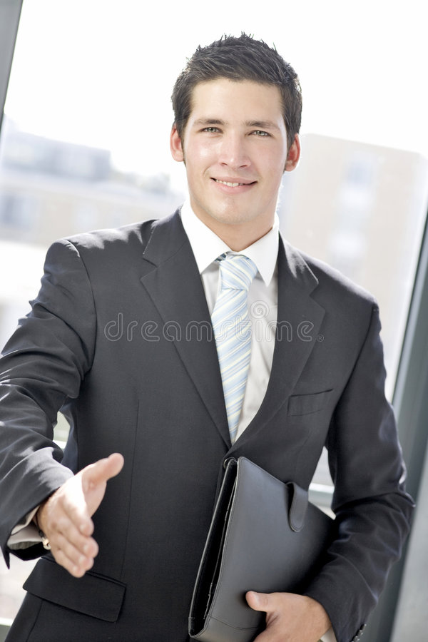 Young business man greeting royalty free stock photography