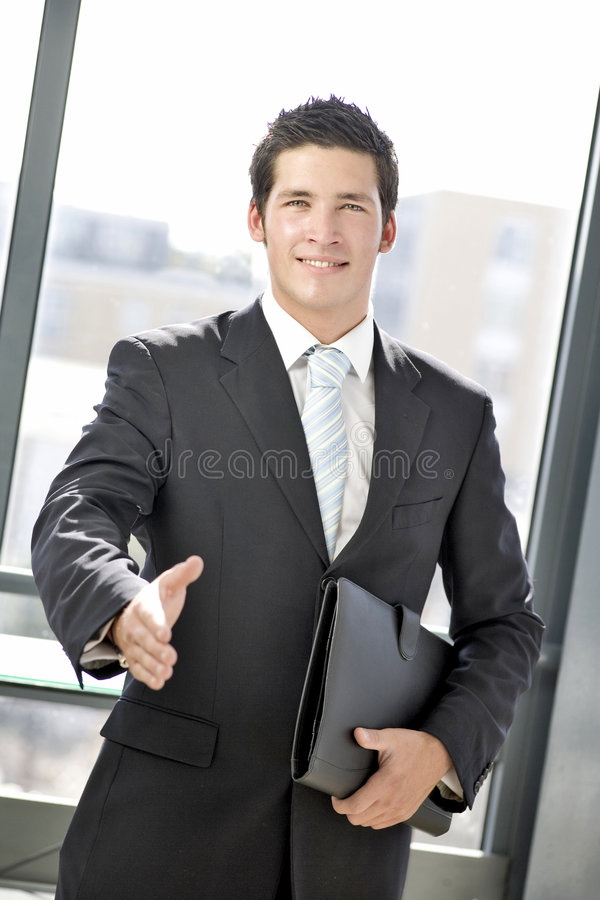 Young business man greeting stock photos