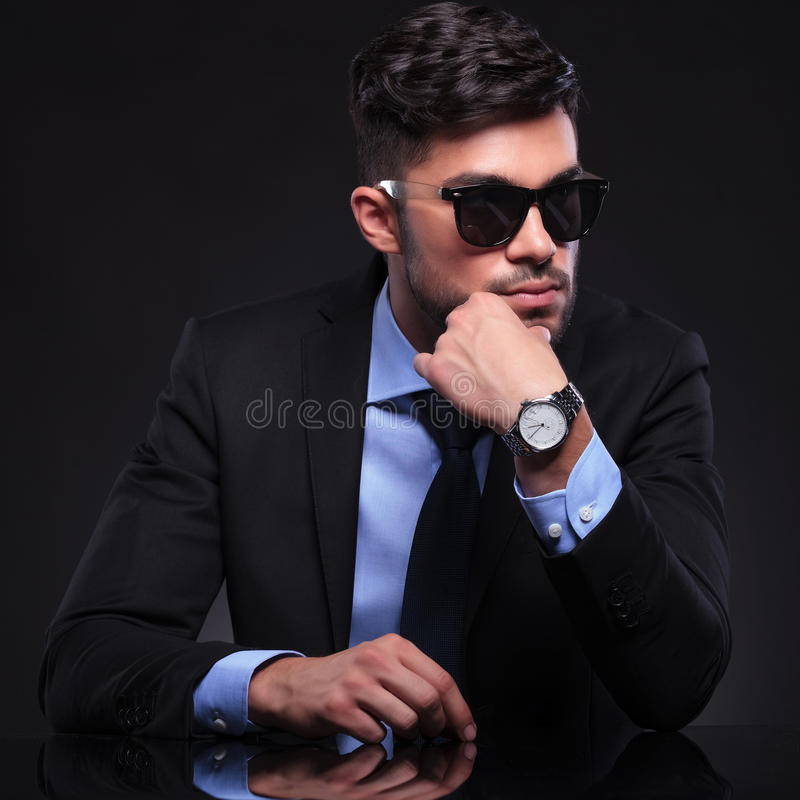 Young business man with hand on chin stock photos