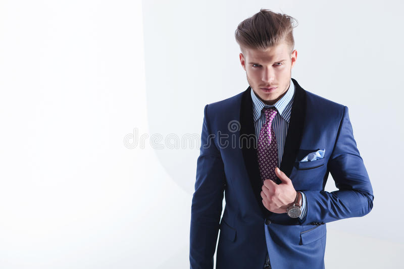 Young business man with hand on jacket lapel royalty free stock photography