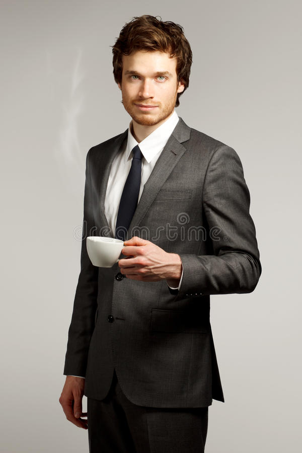 Young Business Man Holding a Cup