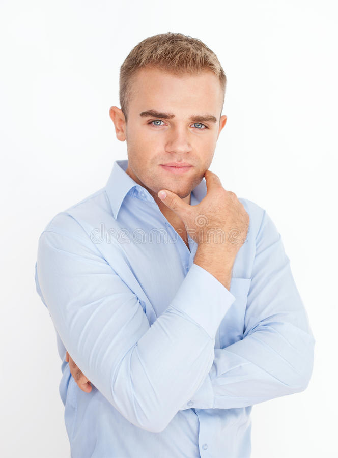 Young business man holding hand up to chin with arms stock photos