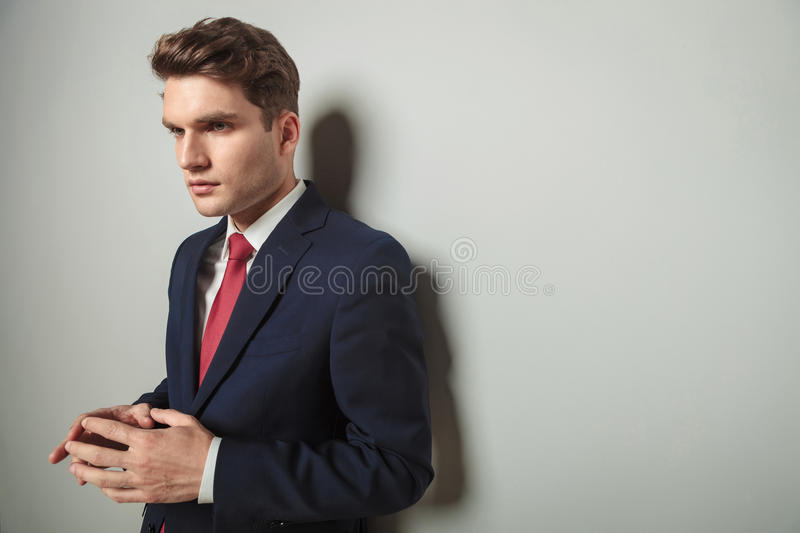 Young business man holding his hands together stock photos