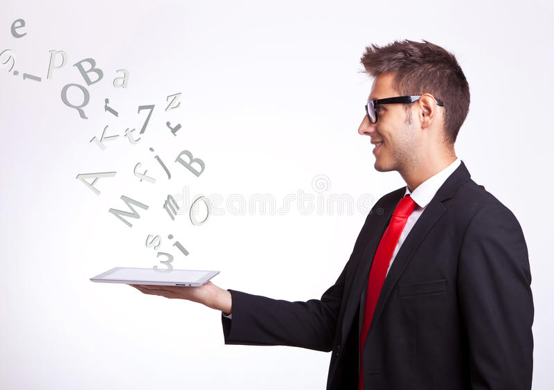 Download Young Business Man Holding A Touch Screen Pad Stock Image - Image: 27318689