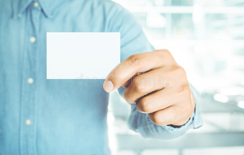Young business man holding white business card royalty free stock photo