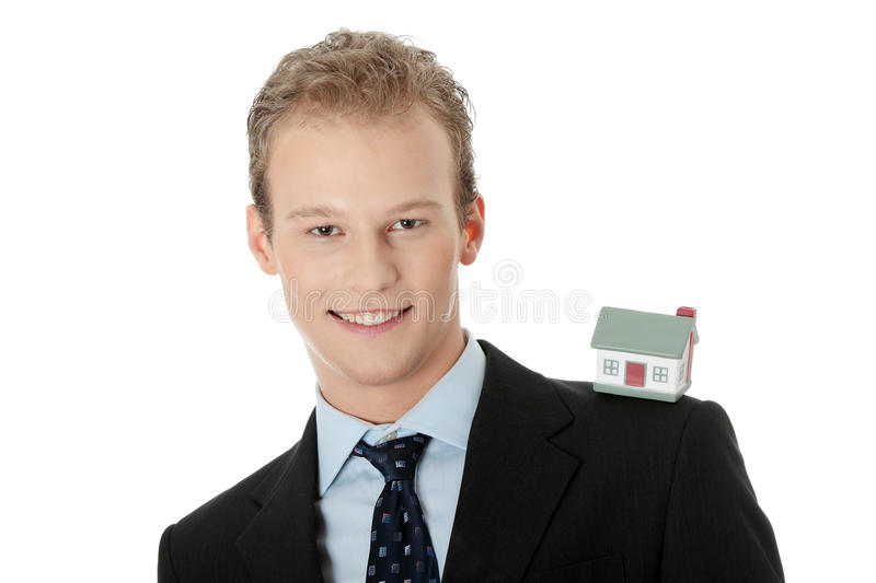 Young business man with house model. Real estate concept. Isolated on white stock photos