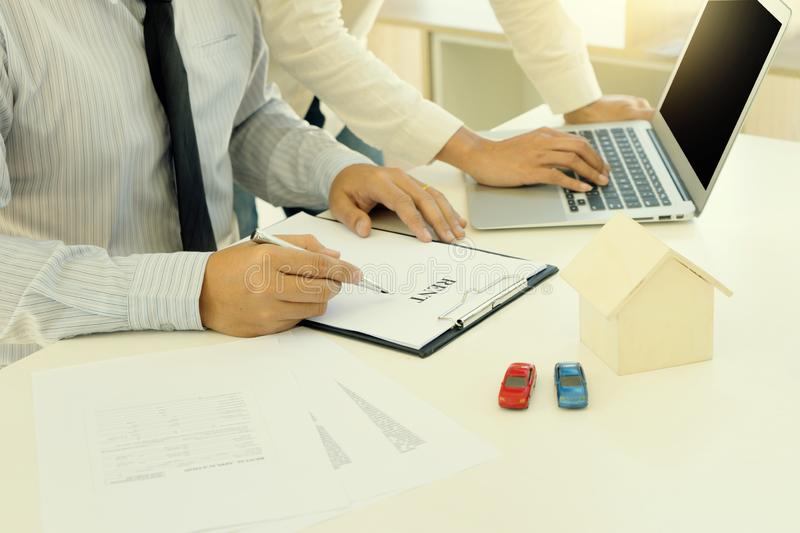 Young Business man insurance agent show document contract royalty free stock images