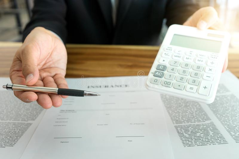 Young Business man insurance agent. Show document contract to the customer at the table in office stock photo