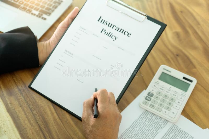 Young Business man insurance agent. Show document contract to the customer at the table in office royalty free stock photo