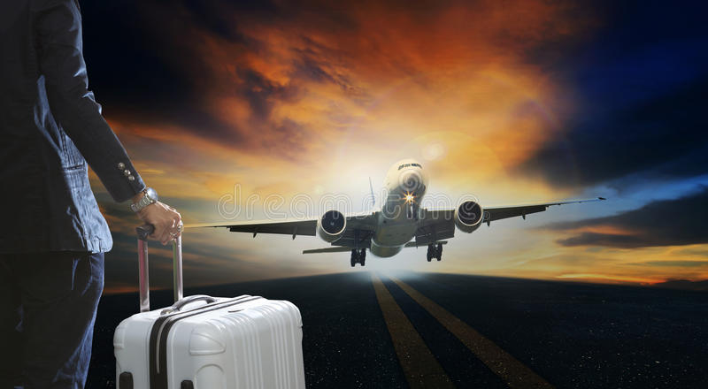 Young business man and luggage suitcase standing with passenger stock photos