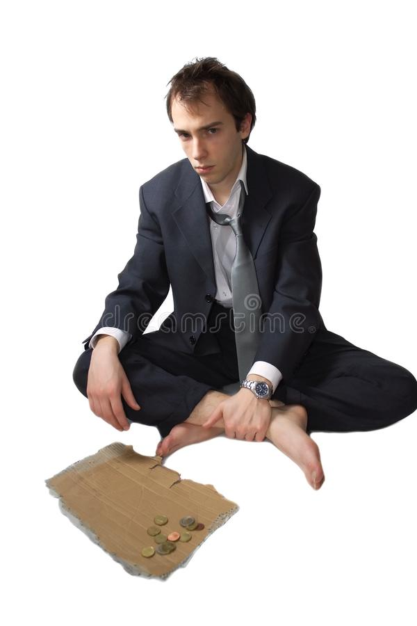 Young business man made redundant begs. And got some change, isolated over white royalty free stock photos