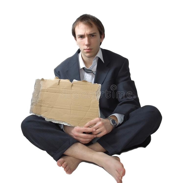 Young business man made redundant shows a sign. Young business man made redundant begs on the street showing a sign stock images