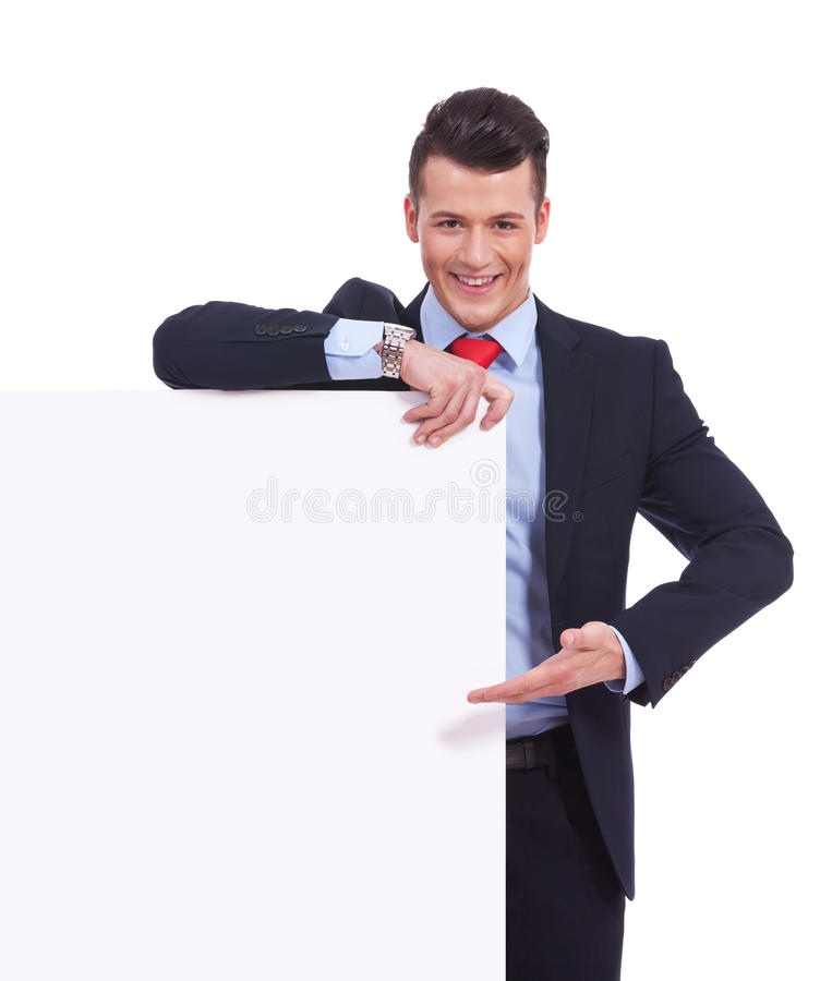 Download Young Business Man Presenting A  Blank Board Stock Image - Image: 25949521