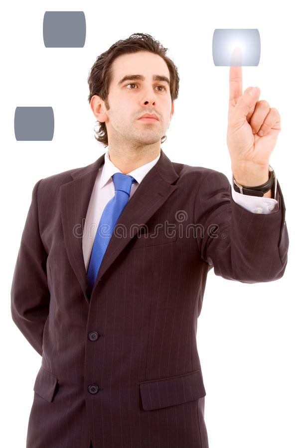 Young business man pressing a touchscreen button royalty free stock image