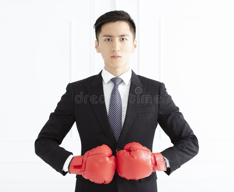 Business man ready to fight with boxing gloves stock photos