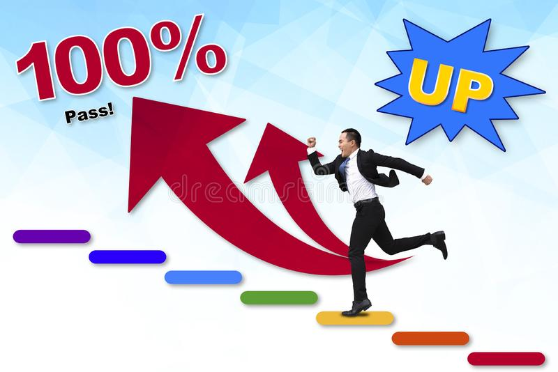 Young Businessman running to the top of graph stock images