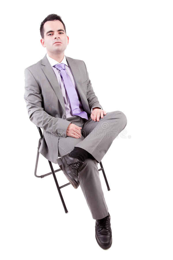 Young business man sitting on a chair stock image