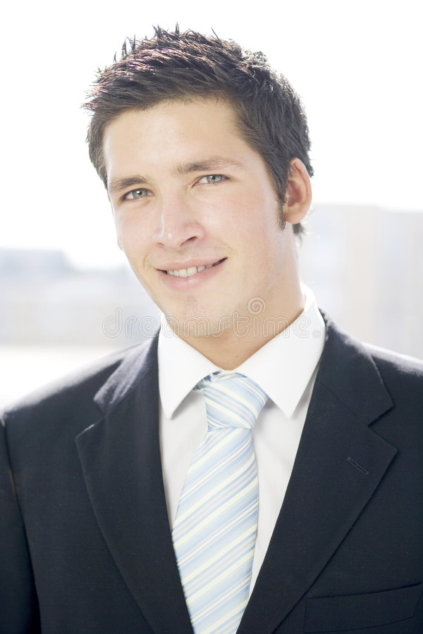 Young business man smiling stock image