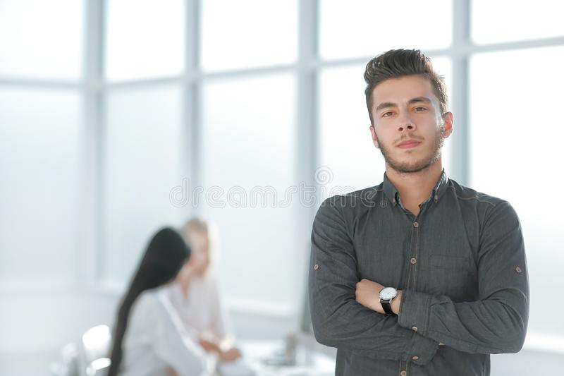 Young business man standing in his office stock photography