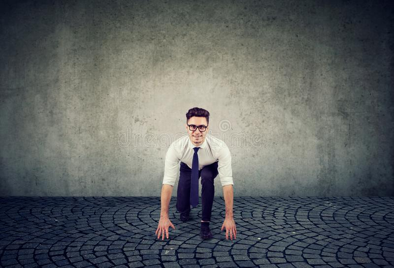 Young business man in the starting position royalty free stock photography