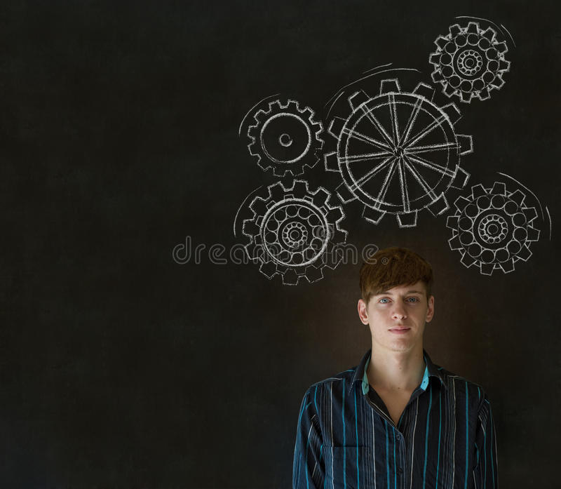 Man thinking with turning gear cogs or gears. Young business man, student or teacher thinking with turning gear cogs or gears stock image
