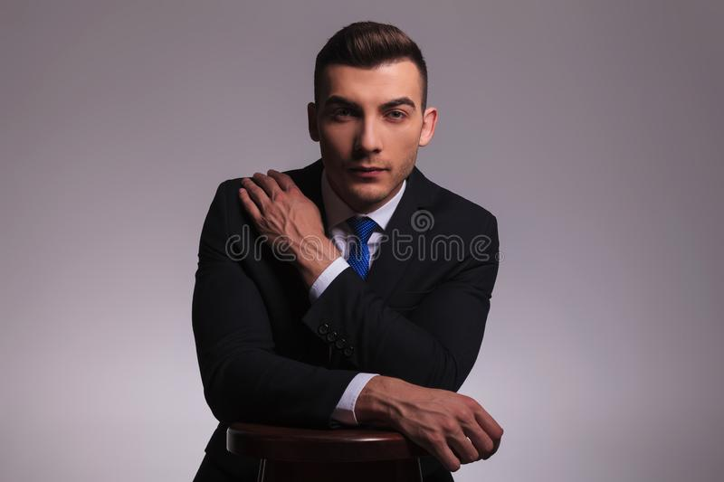 Young business man in suit with hand on shoulder stock photography