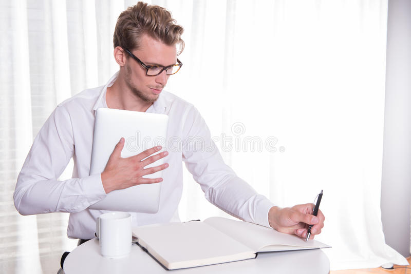 Young business man taking notes stock images