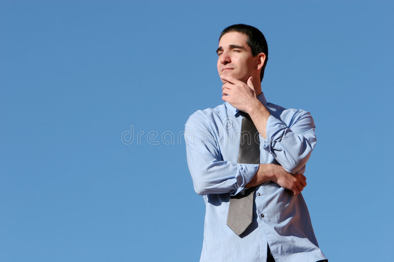 Young business man thinking royalty free stock images
