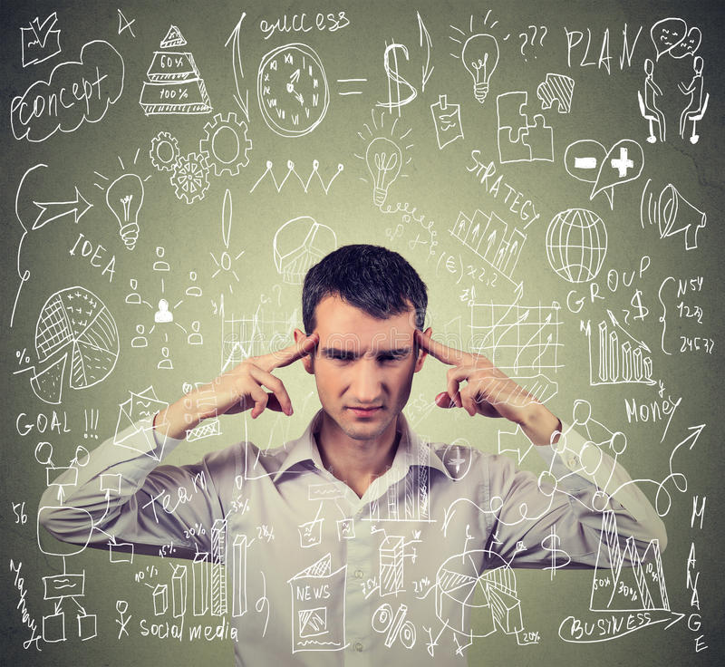 Young business man thinking hard how to manage difficult new project royalty free stock photography