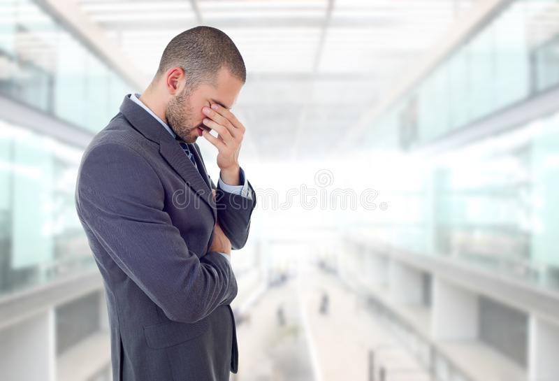 Businessman thinking. Young business man thinking, at the office royalty free stock photography