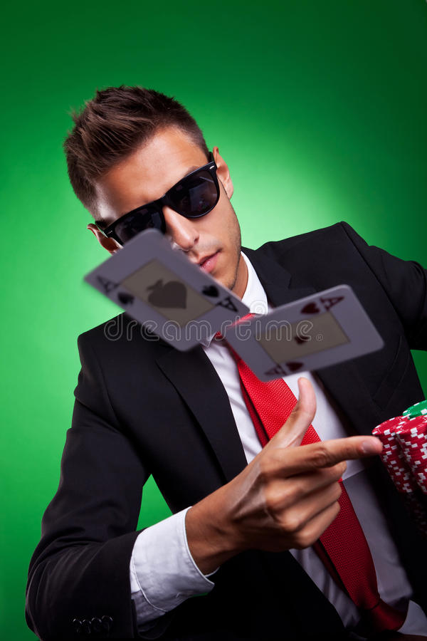Young business man throwing a pair of aces stock photography
