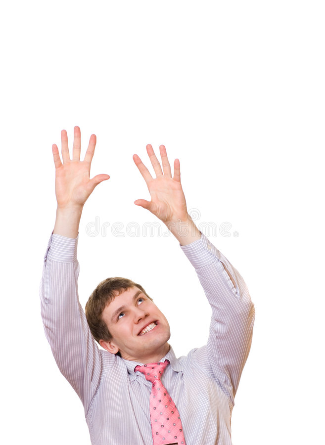 Young business man trying to grab something. Picture of a Young business man trying to grab something royalty free stock photo