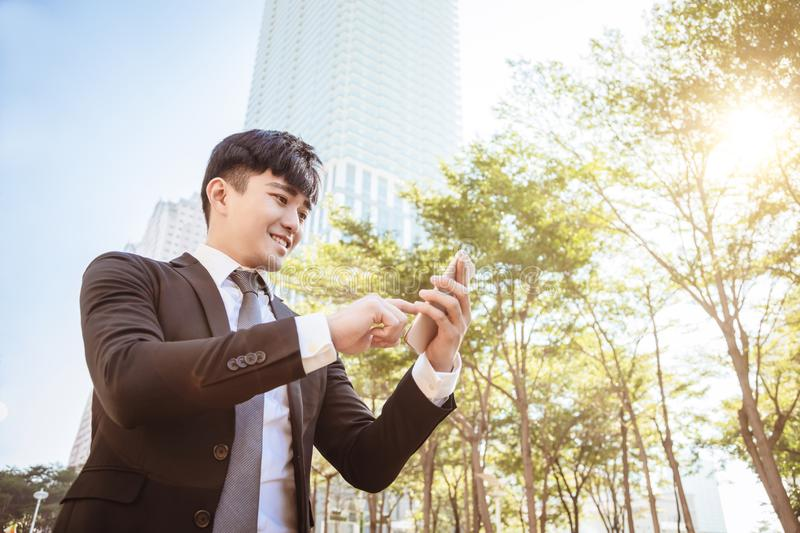 Young business man using mobile phone royalty free stock image