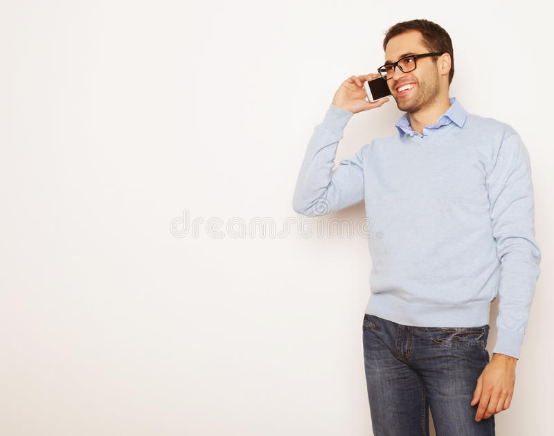Young business man using mobile phone. Life style, business and people concept: Young business man using mobile phone.Over white background stock photos